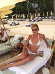 Sunning on the beautiful beach of Amanpuri; Wearing one of my favorite designers Verano High